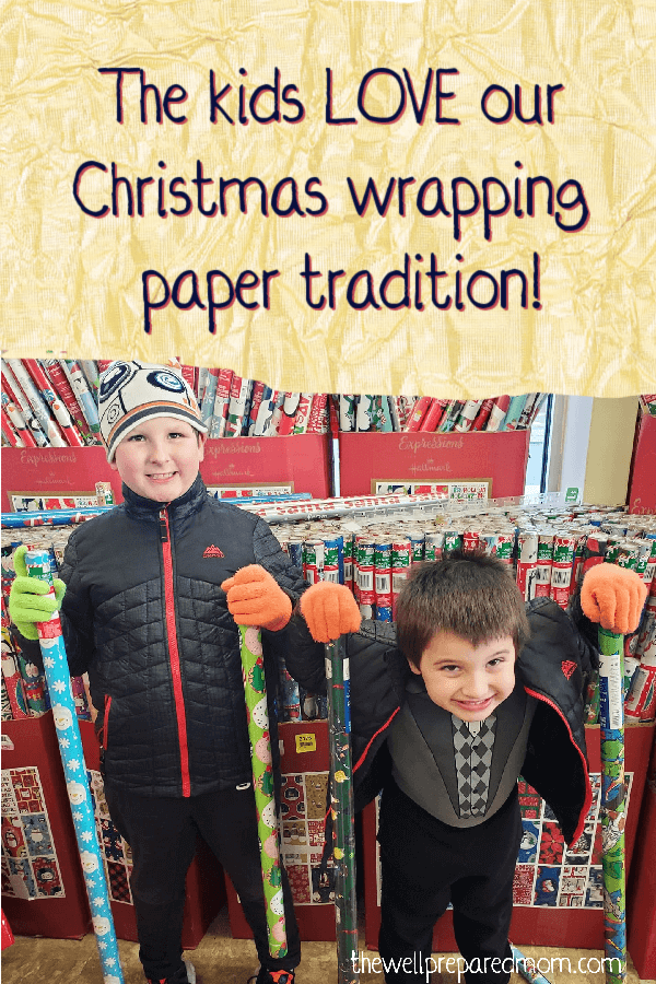 two young boys with wrapping paper they picked for a christmas tradition