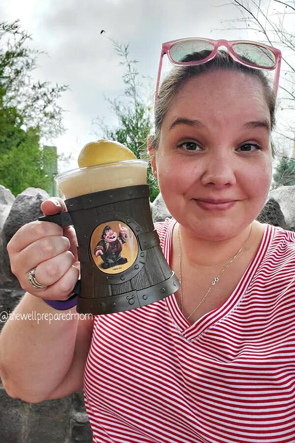 Elizabeth Dukart holding a mug of LeFou's Brew in Walt Disney World.